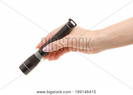 Flashlight in a female hand on a white background isolation