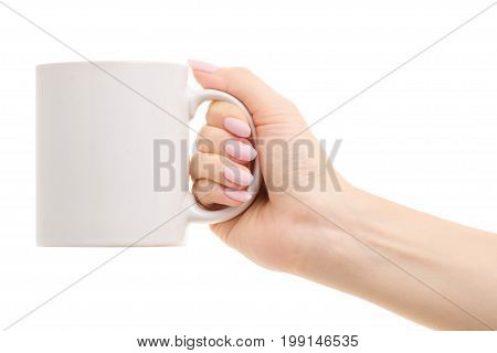 White mug in a female hand on a white background isolation