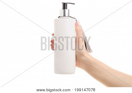 Cream with a dispenser in a female hand on a white background isolation