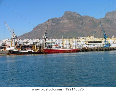 FROM CAPE TOWN, SOUTH AFRICA, PART OF THE VICTORIA AND ALFRED WATERFRONT WITH DEVILS PEAK MOUNTAIN IN THE BACK GROUND