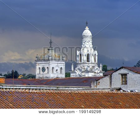 Old church domes in downtown Quito, on a rainy afternoon. Quito, Ecuador