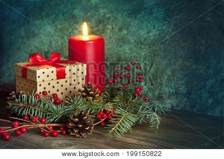 Christmas present with red ribbon decor with red candle