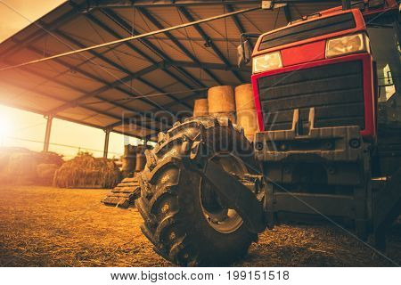 Hay Storage and the Tractor. Farming and Agriculture Theme. Heavy Duty Tractor.