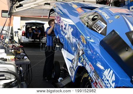 SANOMA, CA - SEPT 29: John Force prepares his Peak Coolant funny car for the starting line during the Toyota NHRA Sanoma Nationals at the Sanoma Raceway in Sanoma, CA on July 29 14, 2017