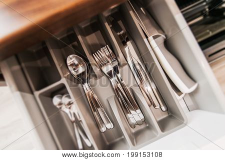 Brand New Silverware Set in a Drawer. Closeup Photo. Kitchen and Dinning Equipment