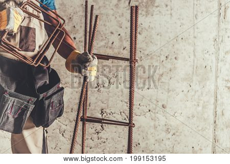 Steel Reinforcement Worker with Rebar Steel Bars Ready To Use. Construction Materials and Technologies.