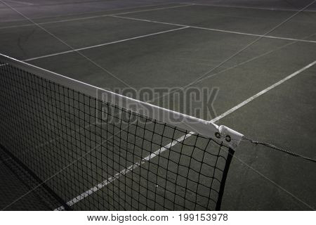 Green and blue tennis net at night