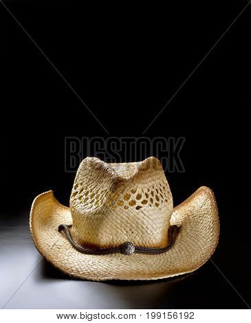 Old cowboy straw hat with lots of room for your type.