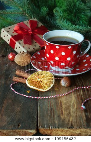 Christmas cup of tea with spice orange and Christmas gift