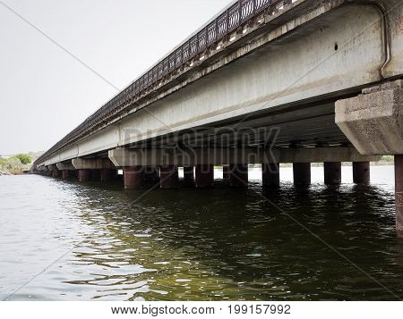 Modern Bridge For The Mass Rapid Transit Near Odessa, Ukraine. Concrete Structure In Need Of Repair.