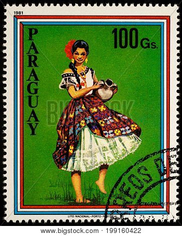Moscow Russia - August 09 2017: A stamp printed in Paraguay shows beautiful young woman in Paraguayan traditional dress with jug series