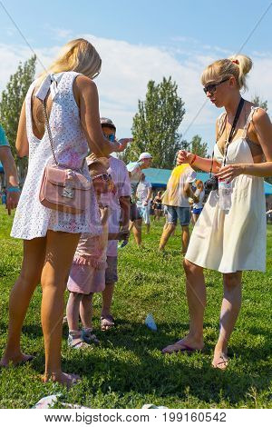 Odessa, Ukraine - August 5, 2017: Two Young Mothers With Small Children During The Festival Of Holi.