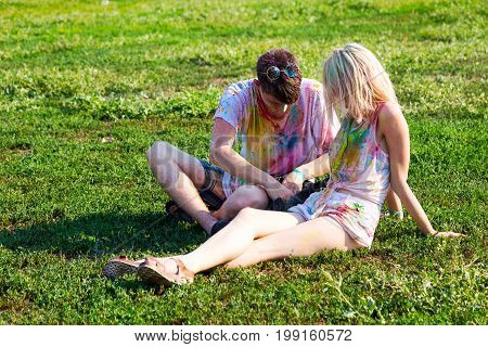 Odessa, Ukraine - August 5, 2017: Young Boy And Girl Resting On A Green Lawn After The Festival Of H
