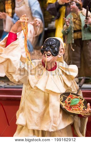 statuette of Pulcinella Napoli 2016 Italy. In the street of San Gregorio Armeno there are numerous workshops of craftsmen who make statues for the crib and statuettes of famous characters or of Neapolitan comedy as the character of the photo.