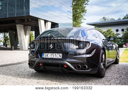 GDYNIA, POLAND - JULY 29, 2017: Black Ferrari FF parked on the street of Gdyia at Baltic Tower, Poland. Ferrari FF is four seats and four wheels drive luxury grand tourer presented by Ferrari in 2011.