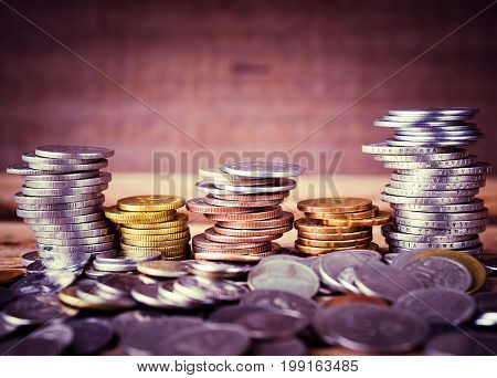 Vintage style of coins stacked on each other in different positions. Money saving concept.