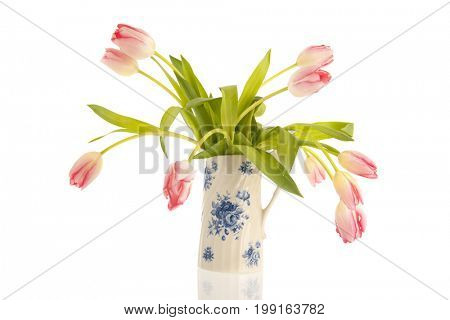 Pink bouquet tulips in typical Dutch vase isolated over white background