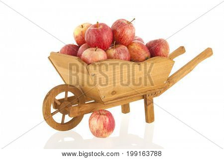 Wheel barrow with red apples isolated over white background