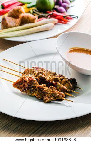 Satay Nua pork kebabs with peanut sauce