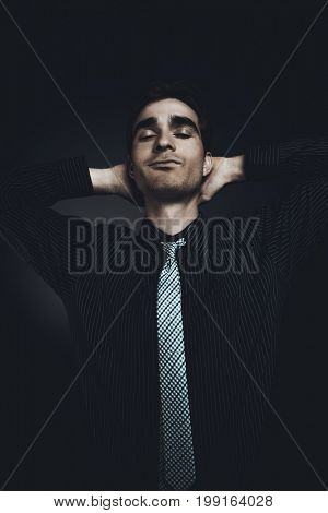 Handsome young man in a suit closed his eyes. Male beauty. Men's health.