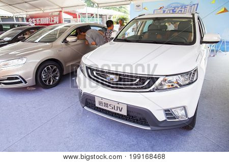 Dongguan, Guangdong, China - August 7, 2017: New Geely brand Chinese automobiles on display at Dongguan car exhibition awaiting prospective buyers