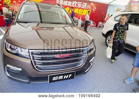 Dongguan, Guangdong, China - August 7, 2017: Haval Chinese automobiles on display at Dongguan car exhibition awaiting prospective buyers