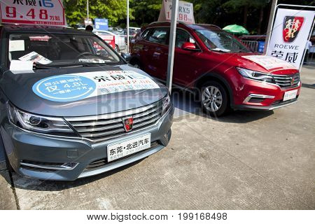 Dongguan, Guangdong, China - August 7, 2017: Roewe Chinese automobiles on display at Dongguan car exhibition awaiting prospective buyers