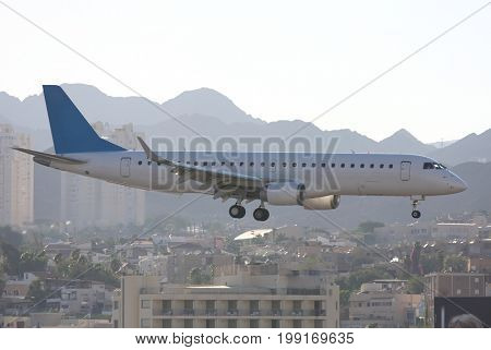 The passenger plane goes on landing at the airport of Eylat
