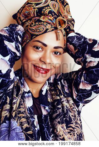 beauty bright real african woman with creative make up, shawl on head like cubian closeup smiling