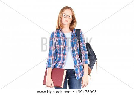 Female teenage student posing with textbook against white background