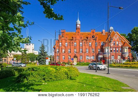 TCZEW, POLAND - AUGUST 8, 2017: Beautiful architecture of neo-gothic city hall in Tczew city, Poland.  Tczew is a town at Vistula River in northern Poland.