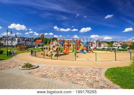 TCZEW, POLAND - AUGUST 8, 2017: Playground park on riverbanks of Vistula river in Tczew, Poland. Tczew is a town at Vistula River in northern Poland.