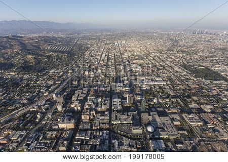 Smoggy afternoon aerial view of Hollywood and downtown Los Angeles in Southern California.