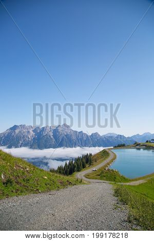 Austrian Alps Salzburg Leogang. Blue Sky Morning Fog Beautiful Scenery Austrian Alps In Summer