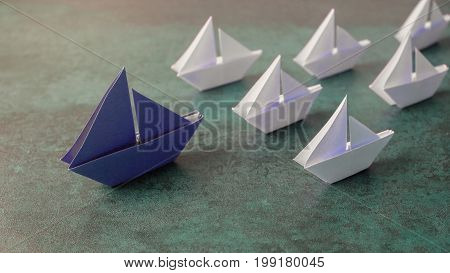 Origami paper sailboats leadership business concept toning banner