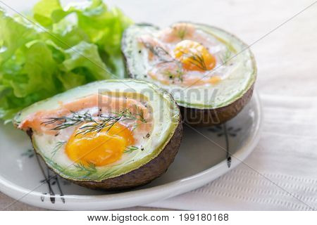 Baked smoked salmon egg in avodaco ketogenic keto low carb diet food