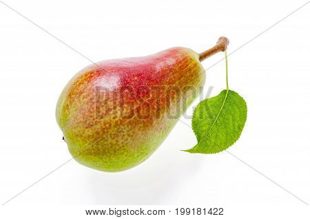 Ripe juicy half green half red pear with leaf. Isolated on white.