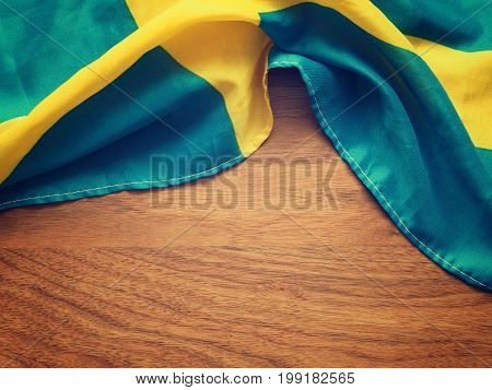 Flag of Sweden on a wooden background with space for text