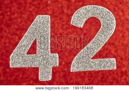Number forty-two silver color over a red background. Anniversary. Horizontal