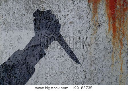 Silhouette of human hand with killing knife on bloody wall background. Illustration for criminal chronicles.