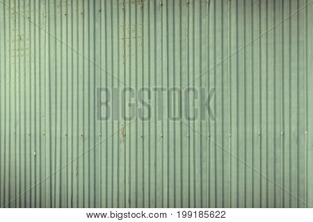 Green Corrugated Metal Wall Or Fence.