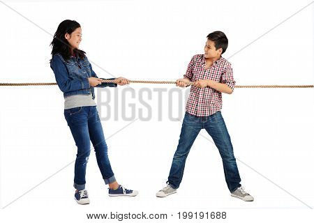 Brother and sister playing tug of war, isolated on white
