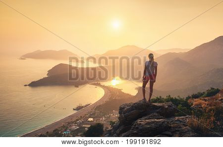 Landscape With Girl, Sea, Mountain Ridges And Orange Sky