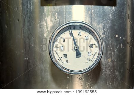 Close up thermomether on metal tank for wine production