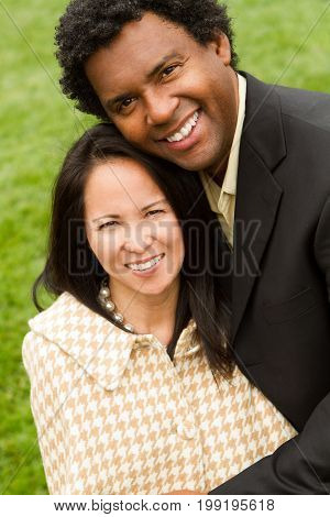Happy African American man with his Asian wife.