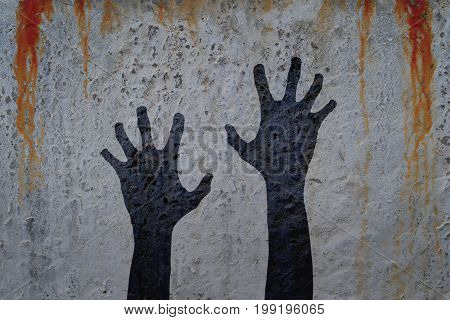 Two corpse hands silhouette in shadow on bloody wall background. Halloween and zombie theme illustration.