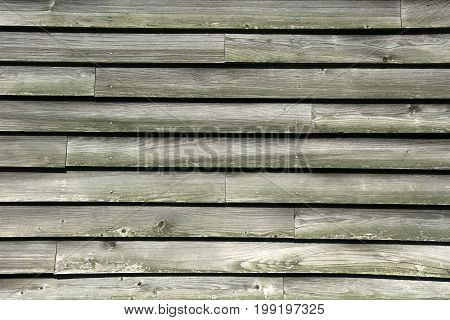 Background of gray weathered old wooden boards