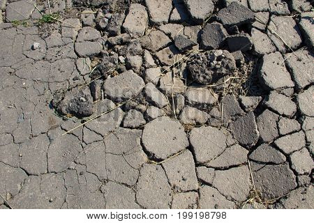 Smashed Asphalt. Closeup Of Broken Road