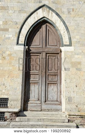 Siena Italy - 6 July 2017: Door of Salimbeni palace on Duomo square at Siena in Italy