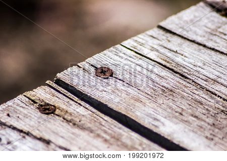 A Macro Close-up Of Screws On Old Wooden Planks